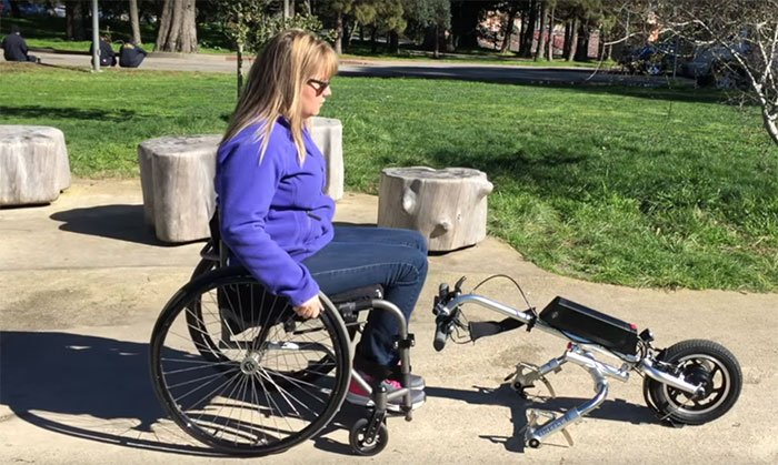 Electric handcycle converts manual wheelchair into a motorized device