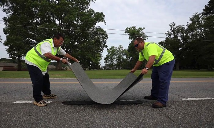 Adhesive patch can seal potholes and cracks on the road
